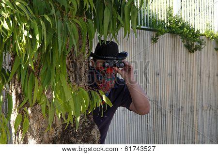 Cowboy In Bandana Looking Through Binoculars