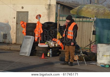 KIEV, UKRAINE - FEB 24, 2014: Traffic regulation point,created people Self defense of Kiev.Troeshina district . Riot in Kiev and Western Ukraine