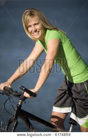Woman On Bike Smiling