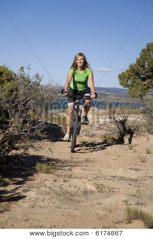 Woman On Bike On Trail
