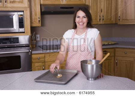 Woman Scooping Cookies