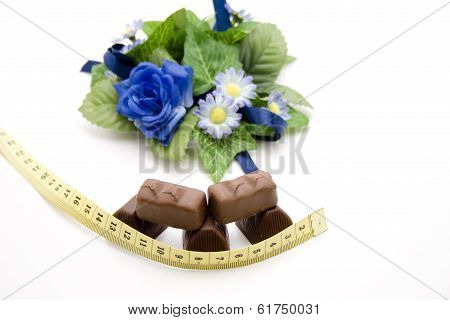 Fresh Chocolate Pieces with Measuring Tape and Flower