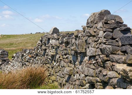 Broken Dry Stone Wall On Moorland