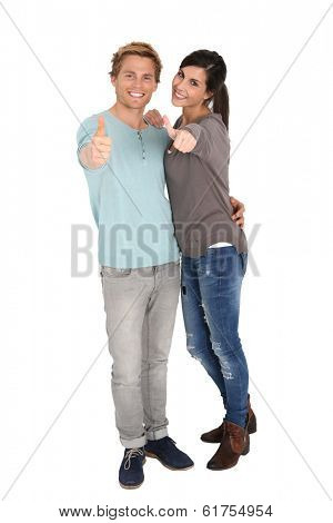 Cheerful young couple showing thumbs up, isolated