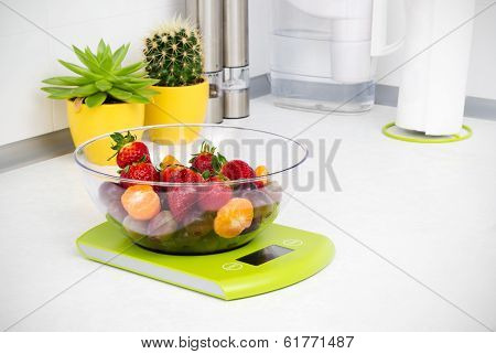 Lots Of Fruit On The Kitchen Scale In A Modern Kitchen