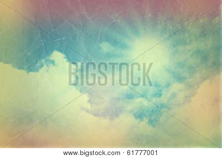 Background of blue sky with fluffy white clouds with vintage effect