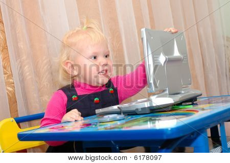 Pretty Little Girl With Child's Computer (notebook).