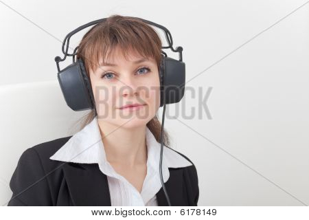 Portrait Of Young Woman With Big Ear-phones On Head