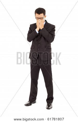 Tired Young Businessman Rubbing His Eyes
