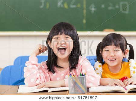 Cute Smiling Kids In The Classroom