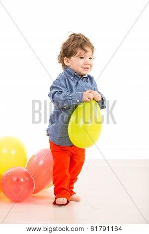 Toddler Walking With Balloon