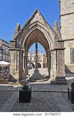 Guimaraes, Portugal - October 13, 2013: Salado Monument (Padrao do Salado), built in the 14th century to commemorate the victory of the Salado battle in Oliveira Square. UNESCO World Heritage Site.