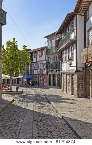 Guimaraes, Portugal - October 13, 2013: Medieval street of the Historical Center of Guimaraes. UNESCO World Heritage Site.