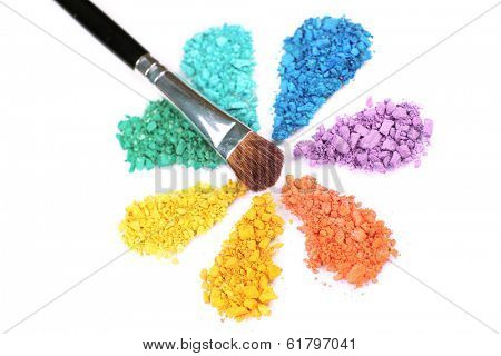 Rainbow crushed eyeshadow in shape of flower isolated on white
