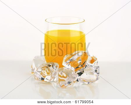 glass with orange juice and ice cubes