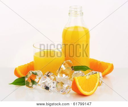 juice in the bottle and in the glass, surround with ice cubes and fresh oranges