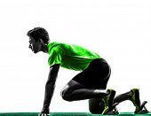 picture of sprinters  - one caucasian man young sprinter runner in starting blocks silhouette studio on white background - JPG