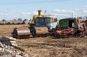 foto of truck farm  - rusting farm machinery in a farm field - JPG