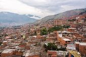 stock photo of medellin  - View of a poor neighborhood in the hills above Medellin Colombia - JPG