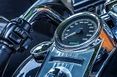 Motorcycle handlebar and speedometer closeup view.