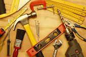 foto of hand drill  - Assorted work tools on wood - JPG