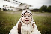 stock photo of fighter plane  - sweet little baby dreaming of being pilot - JPG