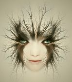 stock photo of surreal  - Artistic surreal portrait of a beautiful face of a young woman transformed in mysterious creature - JPG