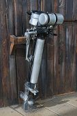 stock photo of outboard  - Old outboard motor placed on a wooden wall - JPG