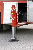 stock photo of fulcrum  - Pneumatic support foot of red fire truck - JPG