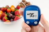 stock photo of diabetes  - Hand holding meter - JPG