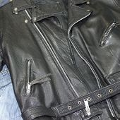 foto of denim wear  - classic style leather studded jacket over denim pants - JPG