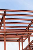 foto of girder  - Metal girders of an unfinished building structure - JPG