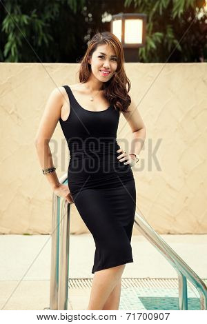 Beautiful young Asian Sexy woman smiling in black dress