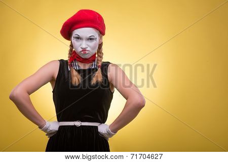 Portrait of female mime isolated on yellow background