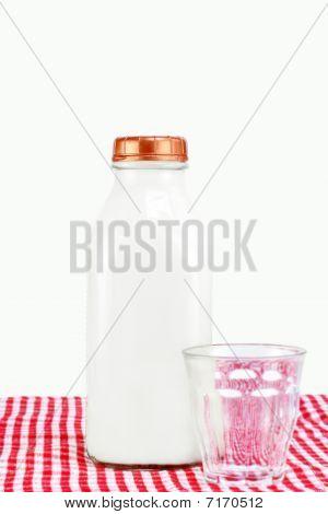 Glass Milk Bottle Of Milk And Glass, Selective Focus On Milk Bottle.