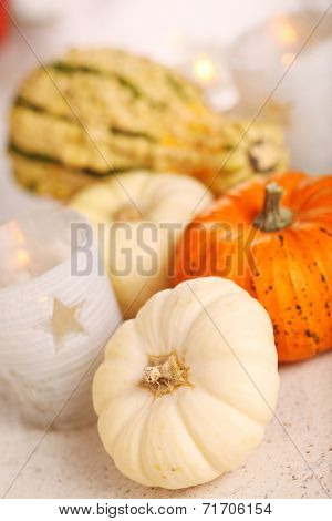 Autumn still-life with pumpkins and candle.
