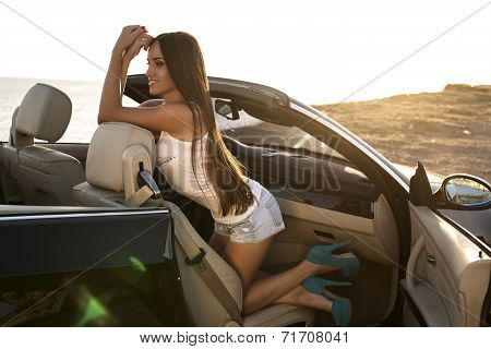 Sexy Girl With Dark Hair Posing In Luxury Cabriolet
