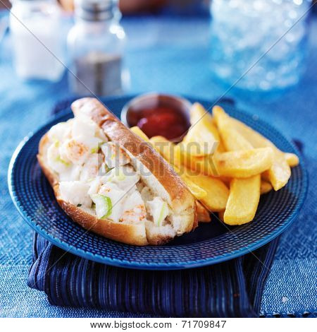 lobster roll and french fries with ketchup