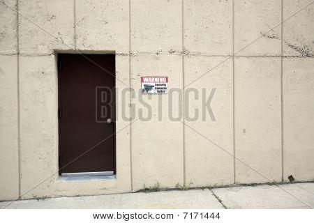 Door In The Concerete Wall