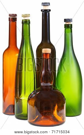 Side View Of Few Empty Closed Wine Bottles