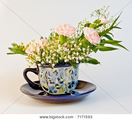 Bunch with dianthus In Cup