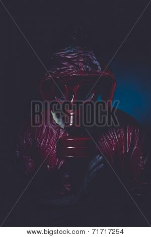 infection nuclear concept, man with red gas mask