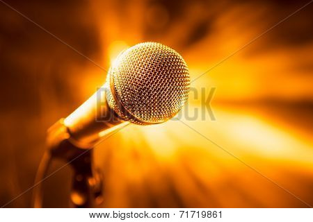 golden microphone on stage