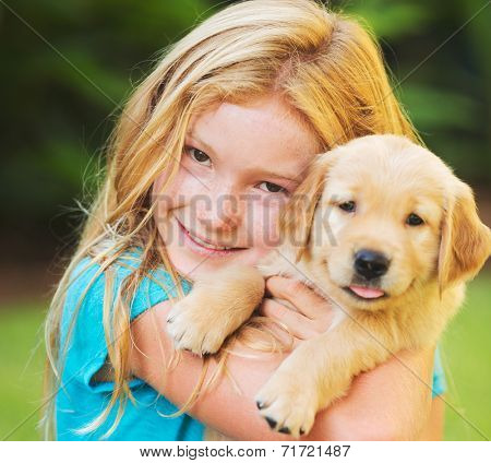 Adorable Cute Young Girl with Golden Retriever Puppy