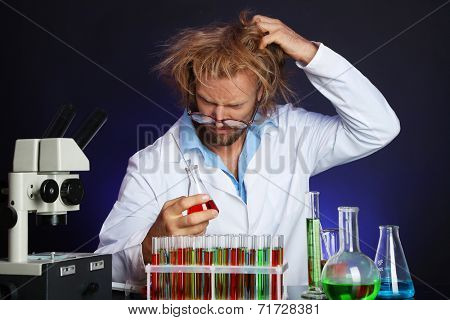 Crazy scientist working in laboratory