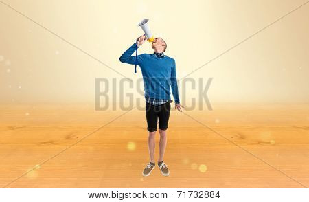 Redhead Man Shouting By Megaphone Over Ocher Background