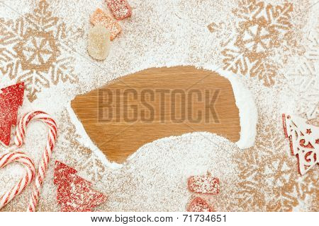 Christmas background with Candies, snowflakes and decorative Christmas Tree on wooden table with copy space for your text