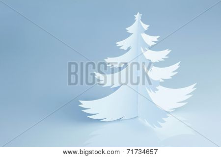 Handmade paper cut Christmas tree on cold white background - horizontal