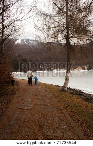 Winter scenery with a father and daughter