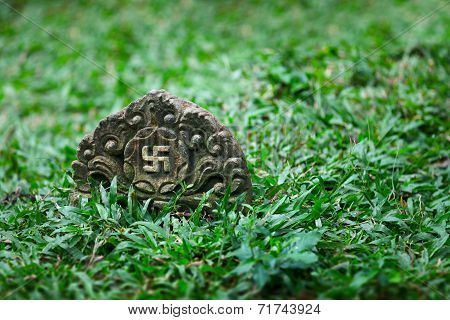 Tombstone With The Image Of Ancient Symbol - The Swastika